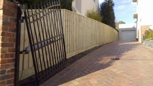 2.0m high paling fence with 200x50 sleeper & 90x45 lip capping.