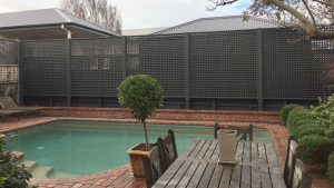 Independent, rebated lattice screen with exposed cypress posts.